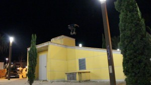 skater-flying-over-a-roof-the-roof-is-on-fire-skate